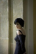Enya: publicity photo, taken by stone arch
