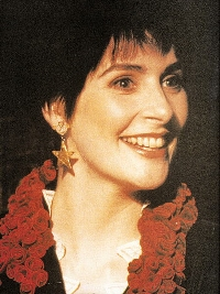 Enya: wearing star earrings, gown from BOD video, 3/4 profile.