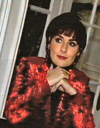 Enya: red velvet jacket
