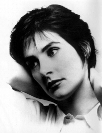Enya: Celts-era photo: head tilted, hand behind neck